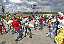 May 20, 2017 - Kiev, Ukraine - Young people beat each other with pillows, as they take part in funny event '' Pillow battle'' in center of Kiev, Ukraine, 20 May, 2017  (Credit Image: © Str/NurPhoto via ZUMA Press)