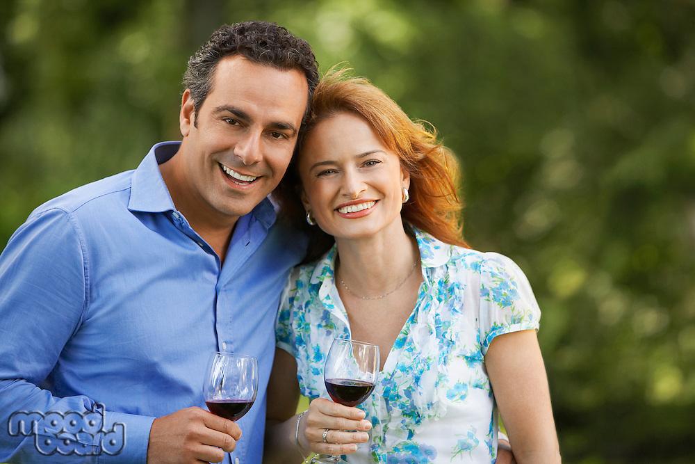 Couple Drinking Wine in back yard portrait