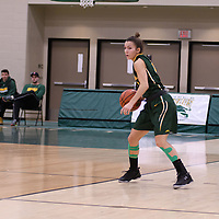 2nd year guard Avery Pearce (4) of the Regina Cougars in action during the home game on November  5 at Centre for Kinesiology, Health and Sport. Credit: Arthur Ward/Arthur Images