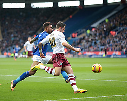 Burnley's Danny Ings and Leicester City's Liam Moore vie for the ball - Photo mandatory by-line: Nigel Pitts-Drake/JMP - Tel: Mobile: 07966 386802 14/12/2013 - SPORT - Football - Leicester - King Power Stadium - Leicester City v Burnley - Sky Bet Championship