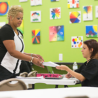 Lead instructor Chandra Pannell collects a test from student Chloe Richardson in the junior and senior level classroom at the Tupelo Academy of Cosmetology. The test went over different techniques of hair styling.