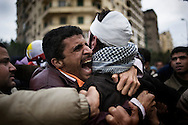 EGYPT, Cairo : Egyptian anti-government protesters calling for the ouster of President Hosni Mubarak at Tahrir Square in Cairo on February 5, 2011.A protester screams to a pro-Mubarak supporter cached and biten by the occupants © ALESSIO ROMENZI