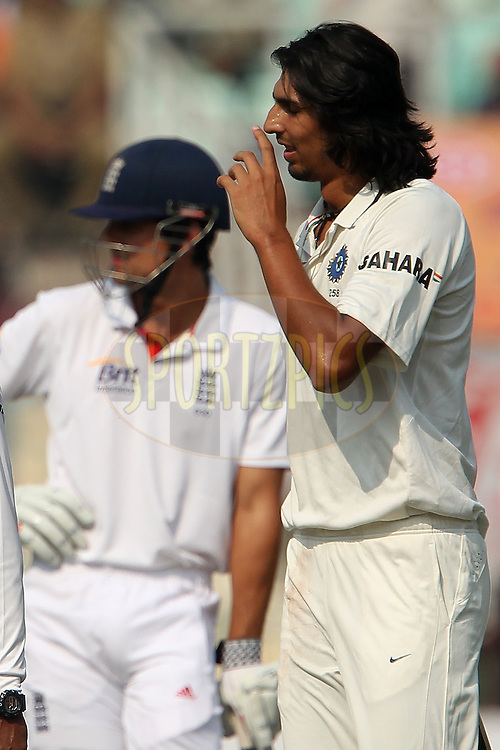 Ishant Sharma of India reacts after dropping the catch for the wicket of Alastair Cook - Captain of England as Cook looks on during day three of the 3rd Airtel Test Match between India and England held at Eden Gardens in Kolkata on the 7th December 2012..Photo by Ron Gaunt/BCCI/SPORTZPICS ..Use of this image is subject to the terms and conditions as outlined by the BCCI. These terms can be found by following this link:..http://www.sportzpics.co.za/image/I0000SoRagM2cIEc