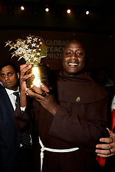 Kenyan Peter Tabichi, teacher at Keriko Secondary School in Nakuru, Kenya poses with his «Global Teacher Prize 2019» in Dubai, United Arab Emirates, on March 24, 2019. The Global Teacher Prize serves to underline the importance of educators and the fact that, throughout the world, their efforts deserve to be recognised and celebrated. The US $1 million award from the Varkey Foundation is presented annually to an exceptional teacher who has made an outstanding contribution to their profession. Photo by GESF-Balkis Press/ABACAPRESS.COM