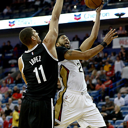 Jan 20, 2017; New Orleans, LA, USA; New Orleans Pelicans forward Anthony Davis (23) shoots over Brooklyn Nets center Brook Lopez (11) during the first quarter of a game at the Smoothie King Center. Mandatory Credit: Derick E. Hingle-USA TODAY Sports