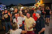 Bands and revelers brought dancing to the streets for the first annual Biketemberfest on Saturday night.  (Karen Bobotas/for the Laconia Daily Sun)