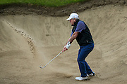 Cricket legend Allan Lamb attempts to get out of a bunker during the BMW PGA Championship Celebrity Pro-Am Day at the Wentworth Club, Virginia Water, United Kingdom on 25 May 2016. Photo by Simon Davies.