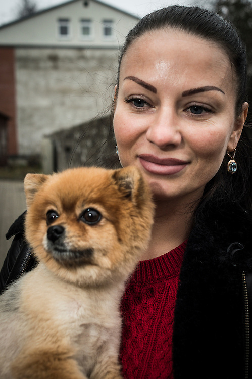 Olga, inhabitant of Daugavpils, Latvia pictured on the street of the city on 13.11.2014.  Latvian city Daugavpils is the largest city in the European Union inhabited by Russian-speaking population. <br /> <br /> The situation of ethnic Russians, who make up 40% of the population of the Baltic countries, is difficult. Lithuania, Latvia and Estonia after independence granted citizenship only to those who were (or whose ancestors were) the citizens of those countries before the Soviet occupation in 1944. <br /> Due to this only in Latvia about 500 000 Russians are without citizenship, since most of these do not want to learn Latvian, nor adapt to a new country with new rules.<br /> Today, there is a growing tendency to accept passports, offered by the Russian government. Some do it for financial reasons, because pensions in Russia are higher than those paid by the Baltic countries. Others take passports for political reasons. Everyone is talking &lsquo;we are left alone by European Union&rsquo;.<br /> <br /> by Wiktor Dabkowski