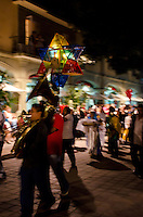 A marching band leads a posada in Christmas Eve in Oaxaca, Mexico.