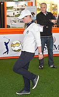 AMSTERDAM - Professional golfer Christel Boeljon aan de voetbal, in een team met John Bosman. Golfbeurs , Amsterdam Golf Show, in de Amsterdamse Rai. COPYRIGHT KOEN SUYK