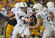 October 20 2012: Penn State Nittany Lions quarterback Matthew McGloin (11) hands the ball off to running back Zach Zwinak (28) during the second half of the NCAA football game between the Penn State Nittany Lions and the Iowa Hawkeyes at Kinnick Stadium in Iowa City, Iowa on Saturday October 20, 2012. Penn State defeated Iowa 38-14.