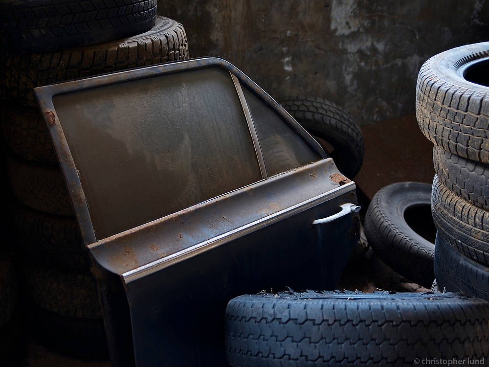 Old car door and tires. From inside the old Herring Factory in Djúpavík, Strandir, Nortwest Iceland.