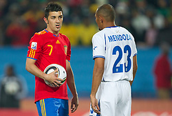 David Villa of Spain and Sergio Mendoza of Honduras before penalty shot of Villa during the 2010 FIFA World Cup South Africa Group H Second Round match between Spain and Honduras on June 21, 2010 at Ellis Park Stadium, Johannesburg, South Africa.  Spain defeated Honduras 2-0. (Photo by Vid Ponikvar / Sportida)