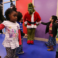 """The Grinch"" meets students froom ECEC before he takes pictures with each class on Monday."