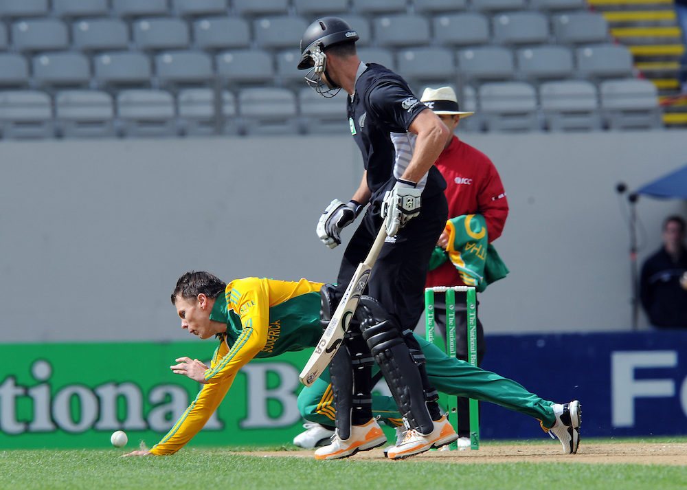 South Africa's Johan Botha fields off his own bowling behind New Zealand's James Franklin in the third one day International Cricket match, Eden Park, Auckland, New Zealand, Wednesday, February 29, 2012. Credit:SNPA / Ross Setford