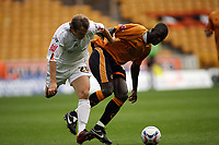 Photo: Rich Eaton.<br /> <br /> Wolverhampton Wanderers v Luton Town. Coca Cola Championship. 26/08/2006. Carl Cort right of Wolves and Markus Heikkinen of Luton go for the ball