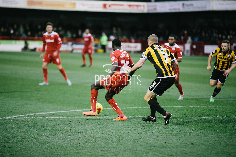 crawleys bawling under pressure from vale's dickson during the Sky Bet League 1 match between Crawley Town and Port Vale at Broadfield Stadium, Crawley, England on 20 December 2014. Photo by Sam Shaw.
