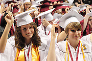 New graduates turn their tassels during the 142nd annual Lebanon High School commencement at the Nutter Center in Fairborn, Saturday, May 26, 2012.