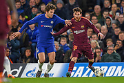 Barcelona forward Lionel Messi  (10) and Chelsea defender Marcos Alonso  (3) during the Champions League match between Chelsea and Barcelona at Stamford Bridge, London, England on 20 February 2018. Picture by Martin Cole.
