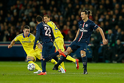 Zlatan Ibrahimovic of Paris Saint-Germain is challenged by Gary Cahill of Chelsea - Photo mandatory by-line: Rogan Thomson/JMP - 07966 386802 - 17/02/2015 - SPORT - FOOTBALL - Paris, France - Parc des Princes - Paris Saint-Germain v Chelsea - UEFA Champions League, Last 16, First Leg.