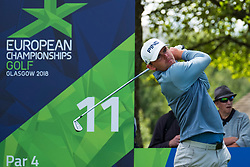 Gleneagles, Scotland, UK; 9 August, 2018.  Day two of European Championships 2018 competition at Gleneagles. Men's and Women's Team Championships Round Robin Group Stage - 2nd Round. Four Ball Match Play format. Liam Johnstone of team GB tees off on the 11th hole