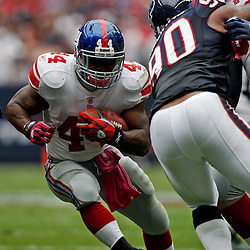 October 10, 2010; Houston, TX USA; New York Giants running back Ahmad Bradshaw (44) runs past Houston Texans defensive end Mario Williams (90) who is blocked by tight end Bear Pascoe (86) during the first half at Reliant Stadium. Mandatory Credit: Derick E. Hingle
