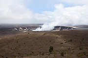 Big Island. Hawai'i Volcanoes National Park. Halema'uma'u Crater in the Kilauea Caldera, spewing sulfur dioxide since 2008.