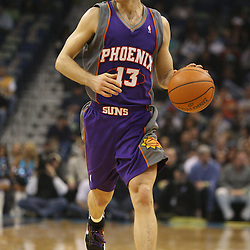 Feb 01, 2010; New Orleans, LA, USA; Phoenix Suns guard Steve Nash (13) drives with the ball against the New Orleans Hornets during the first half at the New Orleans Arena. Mandatory Credit: Derick E. Hingle-US PRESSWIRE