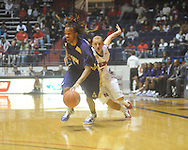 """Alcorn State's Keith Searcy (1) dribbles against Ole Miss guard Will Bogan (3) at the C.M. """"Tad"""" Smith Coliseum in Oxford, Miss. on Thursday, December 29, 2010. Ole Miss won 100-62. (AP Photo/Oxford Eagle, Bruce Newman)"""