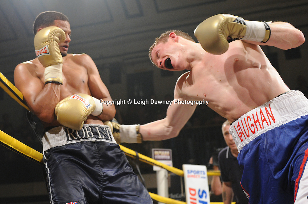Robert Lloyd Taylor (charcoal shorts) defeats Peter Vaughan in Semi Final One of Prizefighter  - The Light Middleweights II. York Hall, Bethnal Green, London, UK. 15th September 2011. Photo credit: © Leigh Dawney.