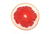 Close up of grapefruit slice on white background