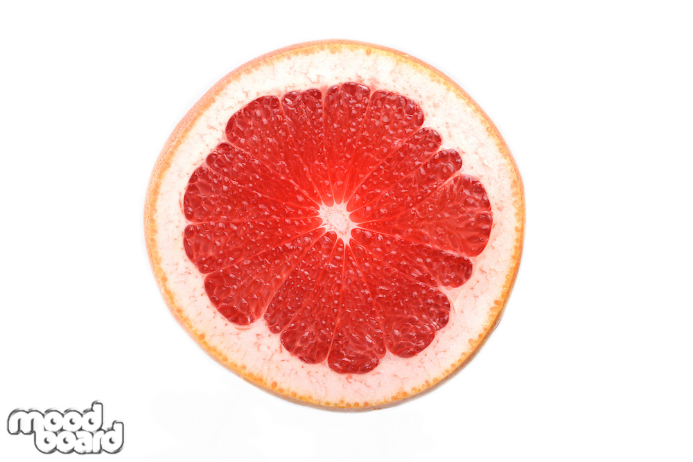 Close up of grapefruit slice on white background
