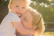 Mother and 21 month old daughter hugging, Caloundra, Sunshine Coast, Queensland, Australia