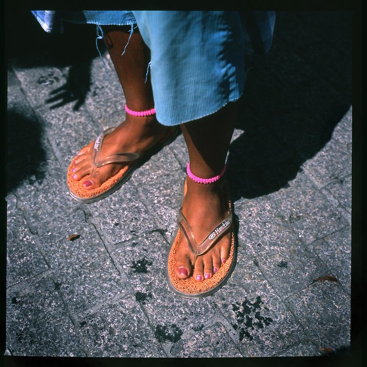 Gal-o boy's painted toenails and slippers, Shibuya, Tokyo, Japan.