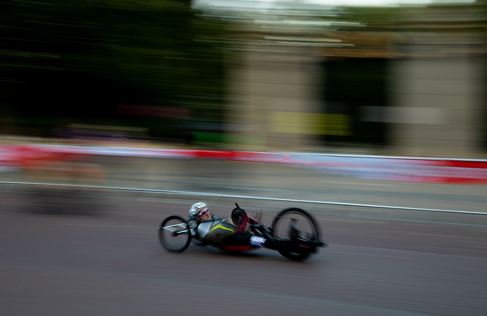 Slow shutter speed effect as a rider cycles up The Mall in The Prudential RideLondon Handcycle Grand Prix. Saturday 28th July 2018<br /> <br /> Photo: Ian Walton for Prudential RideLondon<br /> <br /> Prudential RideLondon is the world's greatest festival of cycling, involving 100,000+ cyclists - from Olympic champions to a free family fun ride - riding in events over closed roads in London and Surrey over the weekend of 28th and 29th July 2018<br /> <br /> See www.PrudentialRideLondon.co.uk for more.<br /> <br /> For further information: media@londonmarathonevents.co.uk