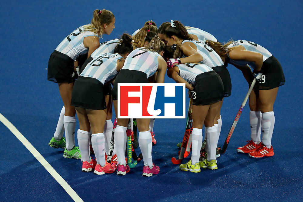 RIO DE JANEIRO, BRAZIL - AUGUST 08:  Argentina huddles against Japan during a Women's Pool B match on Day 3 of the Rio 2016 Olympic Games at the Olympic Hockey Centre on August 8, 2016 in Rio de Janeiro, Brazil.  (Photo by Sean M. Haffey/Getty Images)