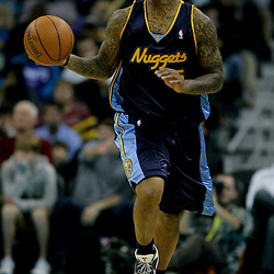 Dec 18, 2009; New Orleans, LA, USA; Denver Nuggets guard J.R. Smith (5) drives with the ball against the New Orleans Hornets during the second half at the New Orleans Arena. The Hornets defeated the Nuggets 98-92. Mandatory Credit: Derick E. Hingle-US PRESSWIRE