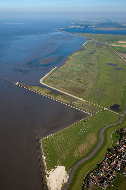 Nederland, Friesland, Gemeente Dongeradeel, 08-09-2009; Peazemerlannen, kweldergebied grenzend aan het Wierumerwad en de Waddenzeee. Onder in beeld het 'duo-dorp' Paesens-Moddergat, aan de verre horizon het Lauwersmeer. Het buitendijkse natuurgebied, in beheer bij  It Fryske Gea, is ontstaan door spontane uitpoldering bij een zware storm in 1973 waarbij er een gat geslagen werd in de bitumendijk. .The village Paesens and Peazemerlannen, salt marshes bordering the Wierumerwad and Waddenzeee. The area has been created in 1973, a severe storm made a hole in the outside polder dike. The area is a nature reserve, managed by It Fryske Gea.luchtfoto (toeslag); aerial photo (additional fee required); .foto Siebe Swart / photo Siebe Swart