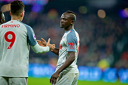 LONDON, ENGLAND - Monday, February 4, 2019: Liverpool's Sadio Mane celebrates scoring the first goal with team-mate Roberto Firmino during the FA Premier League match between West Ham United FC and Liverpool FC at the London Stadium. (Pic by David Rawcliffe/Propaganda)
