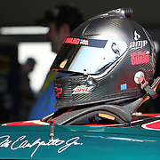 Sprint Cup Series driver Dale Earnhardt Jrs  helmet sits  in the garage at the Daytona International Speedway on February 18, 2011 in Daytona Beach, Florida. (AP Photo/Alex Menendez)