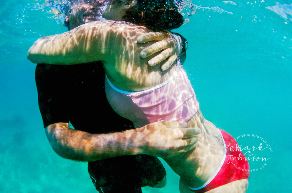 Australia --- Couple Embracing Underwater