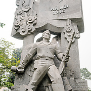 A Communist-style stone statue celebrating Hanoi in the city's Old Quarter.