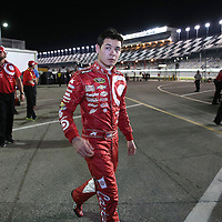 Driver Kyle Larson is seen leaving his garage during the  56th Annual NASCAR Daytona 500 practice session at Daytona International Speedway on Wednesday, February 19, 2014 in Daytona Beach, Florida.  (AP Photo/Alex Menendez)