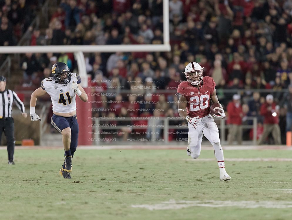PALO ALTO, CA - NOVEMBER 18:  Bryce Love #20 of the Stanford Cardinal runs 57 yards for a touchdown during the annual Big Game against the California Golden Bears played November 18, 2017 at Stanford Stadium in Palo Alto, California.  Defending for Cal is Gerran Brown #41.  (Photo by David Madison/Getty Images)