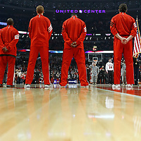 24 March 2012: Chicago players stand during the National Anthem prior to the Chicago Bulls 102-101 victory in overtime over the Toronto Raptors at the United Center, Chicago, Illinois, USA.