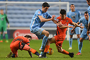 Wycombe Wanderers midfielder Luke O'Nien (17) tackles Coventry City midfielder Peter Vincenti (7) 2-0 during the EFL Sky Bet League 2 match between Coventry City and Wycombe Wanderers at the Ricoh Arena, Coventry, England on 22 December 2017. Photo by Alan Franklin.