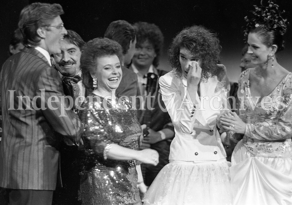 Eurovision Song Contest Winner Celine Dion of Switzerland on stage with Pat Kenny being congratulated in the RDS, Dublin, 30/04/1988 (Part of the Independent Newspapers Ireland/NLI Colection).