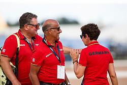 HILBERATH Jonny (Co-Bundestrainer), THEODORESU Monica (Bundestrainerin Dressur), WIEGARD Steffi (Pferdepfleger GER), KOENE Dr. Marc (Tierarzt)<br /> Tryon - FEI World Equestrian Games™ 2018<br /> Backgroundbilder vom Abreiteplatz<br /> Grand Prix de Dressage Teamwertung und Einzelqualifikation<br /> 13. September 2018<br /> © www.sportfotos-lafrentz.de/Sharon Vandeput