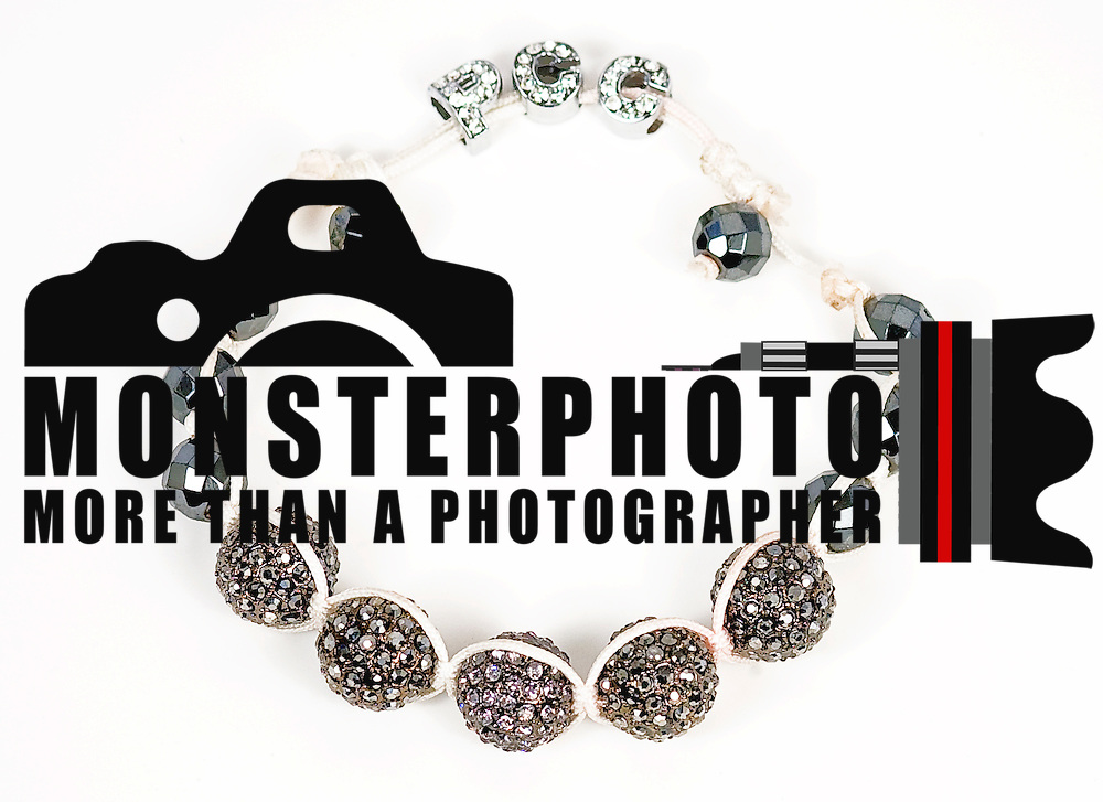 ** Poetik Clothing Company** In this Thursday, Sep. 1, 2011 photo, are Poetik Clothing Company jewelry products Bracelets & Feathered Earrings. (Monsterphoto/Saquan Stimpson)..