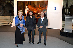 "Left to right, LADY PENNY MOUNTBATTEN, artist RALPH HEIMANS and RUMI VERJEE at a private view to view ""The Coronation Theatre: Portrait of Her Majesty Queen Elizabeth II"" painted by Ralph Heimans held at Westminster Abbey, London on 12th September 2013."